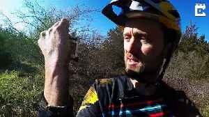 Kindhearted cyclist tracks down owner to return camera that he lost four years ago – capturing the moment it was returned [Video]