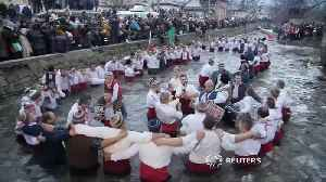 Bulgarians dance in icy river in traditional Epiphany celebration [Video]