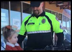 Beats a Tricycle... Officer Lets Little Girl Check Out His Police Motorbike [Video]