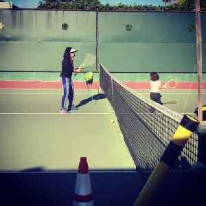 Three Year Old Girl Practices Tennis with Coach [Video]