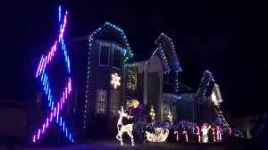 Couple uses Christmas lights to reveal baby's gender [Video]