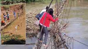 Teachers Make Perilous Commute To Classroom By Walking Across Half-Sunken Rope Bridge [Video]
