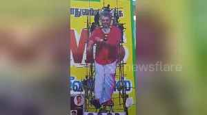 Actor cutout scaffolding collapses as fans climb on top in South India province [Video]