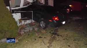 Police: Car crashes into living room, driver arrested [Video]