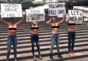 'Let Her In': Topless Protesters Rally For Saudi Refugee Rahaf Mohammed al-Qunun [Video]