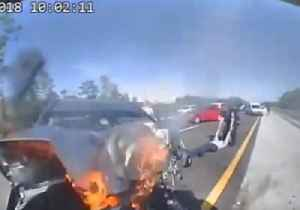 Driver Pulled From Burning Wreck After Crashing Into Police Cruiser [Video]