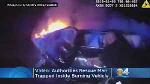 Dramatic Video Shows Florida Officers Rescue Man From Burning Car [Video]