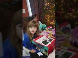Two Girls Get Gaming Console for Christmas [Video]