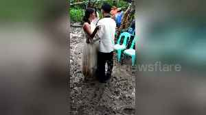 Newlyweds have 'muddy' first dance in typhoon-hit village [Video]