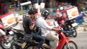 Motorcycle Passengers Carrying Strange Objects [Video]