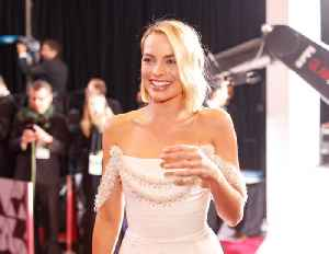Margot Robbie shocked by reaction to regal outfits [Video]