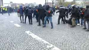 """News video: Teargas fired as """"yellow vest"""" protesters clash with police"""
