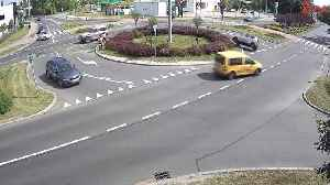 Car Spins Out On Traffic Roundabout [Video]