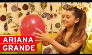 Ariana Grande pops balloons to answer YOUR questions [Video]