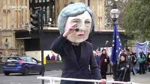 'Theresa May' effigy appears outside Parliament on a ship [Video]