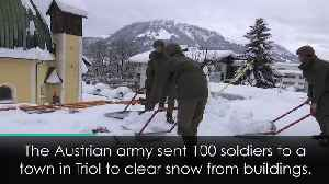 Soliders called in to clear snow in Austria [Video]
