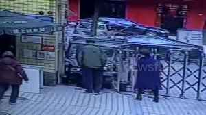News video: Car crashes into security guard as driver mistakes accelerator for brake