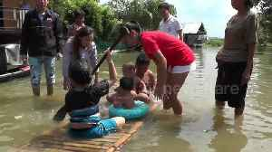 Thai children play in flood waters caused by deadly storm Pabuk [Video]