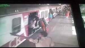 Two women escape unhurt after failing to board moving train in Mumbai railway station [Video]
