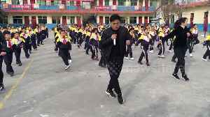 School pupils do choreographed shuffle dance with principal during break [Video]
