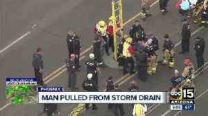 Naked man rescued from Phoenix storm drain [Video]