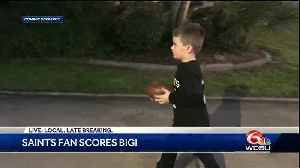 Young Saints fan throws football right into basketball hoop [Video]