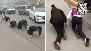 Punished employees forced to crawl on their hands and knees [Video]