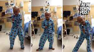 Little Michael Jackson fan tells cancer to 'Beat It' [Video]