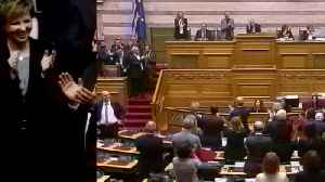 Greek PM narrowly wins confidence vote [Video]