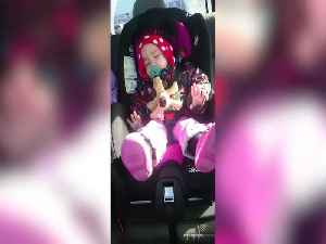 News video: Sleeping Baby Just HAS to Groove to her Favorite Song