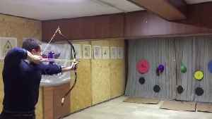 Archer Hits Balloons with Two Arrows at Once [Video]