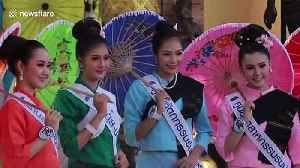 Beautiful scenes from umbrella festival in northern Thailand as local women wear traditional costume [Video]