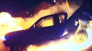 Texas Cops Pull Woman Out of Burning Truck [Video]