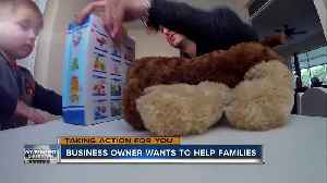 Small business owner adopts the families of two government workers [Video]