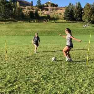 Female Soccer Player Practices Kick Drills with Coach [Video]