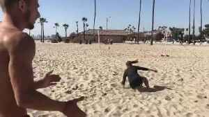 Woman Soccer Player Shoots Bicycle-Kick Goal on Beach [Video]