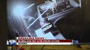 Search on for men who ripped ATM from Ramona store [Video]