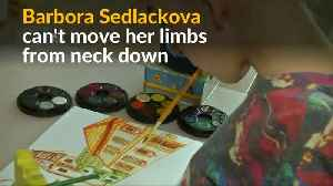 Czech teen with paralysis paints with her mouth [Video]