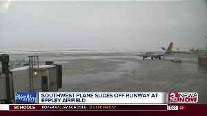 Plane slides off runway at Eppley Airfield [Video]
