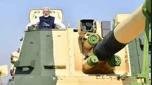 PM Modi rides K9 Vajra Self Propelled Howitzer, Video Viral | Oneindia News [Video]