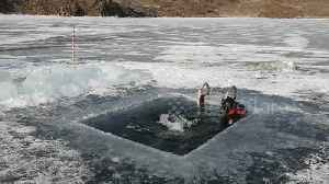 Russian man swims 25m under ice at world's deepest lake [Video]