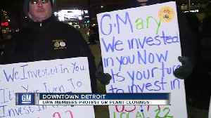 UAW members protest GM plant closings [Video]