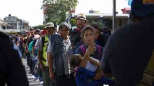 Hundred of migrants from Central America wait in the Mexico immigration line to be processed [Video]