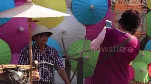 Tourists enjoy colourful umbrella festival in northern Thailand [Video]