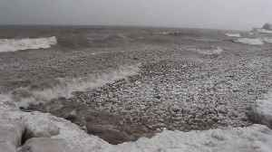 """Winter storm creates thousands of floating """"ice balls"""" [Video]"""