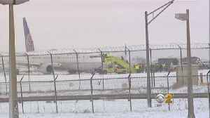 Plane Skids Off Runway At O'Hare [Video]