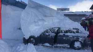 Parked car reverses while under 6ft-high snowdrift in Austrian hotel car park [Video]
