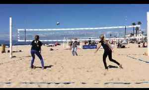 Girls Play Doubles Games of Volleyball [Video]