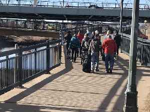 Inspired by shutdown, group of volunteers cleans up Cherry Creek Trail [Video]