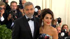 George and Amal Clooney reportedly considering adoption [Video]